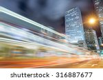 the light trails on the modern... | Shutterstock . vector #316887677