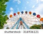 ferris wheel in the green park...   Shutterstock . vector #316936121
