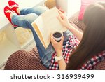 woman sitting on the sofa... | Shutterstock . vector #316939499