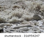 Small Waves Crashing On To The...