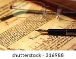 pen   glasses resting on some... | Shutterstock . vector #316988