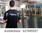 back of a personal trainer in a ... | Shutterstock . vector #317045537