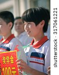 Small photo of XINGTAI CITY CHINA - September 2015: on September 14, 2015, second middle school held the commendation meeting. Unidentified teacher and the student has received the honor. They are very happy.