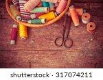 scissors  bobbins with thread... | Shutterstock . vector #317074211