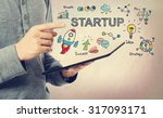 young man pointing at startup... | Shutterstock . vector #317093171