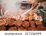 grilling meat with barbecue...   Shutterstock . vector #317106599