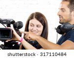 a cameraman and a young woman... | Shutterstock . vector #317110484