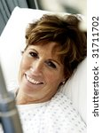 Patient on hospital bed smiling - stock photo