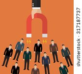 businessman holding magnet... | Shutterstock .eps vector #317187737