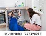 young repairman repairing sink... | Shutterstock . vector #317198057