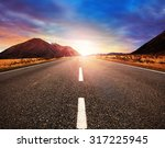 asphalt highway and sun rising... | Shutterstock . vector #317225945