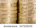 Two Stacks Of Uk Pound Coins...