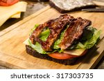 sandwich with fried bacon ... | Shutterstock . vector #317303735