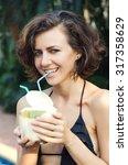 woman in bikini drinks fresh... | Shutterstock . vector #317358629