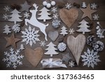 Small photo of Wooden Background With Many Christmas Decoration.Christmas Present, Heart, Snowfalke, Fir Cone, Star, Christmas Tree, Reindeer. Copy Space, Free Text Or Your Text Here. Gray Rustic Or Vintage Style