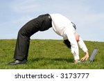 Businessman Bending Over...