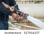 hand of firefighter at works... | Shutterstock . vector #317416157