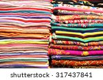 stacks of folded colorful... | Shutterstock . vector #317437841