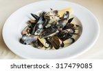 blue mussels white wine sauce  | Shutterstock . vector #317479085