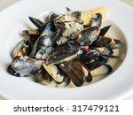 blue mussels white wine sauce  | Shutterstock . vector #317479121