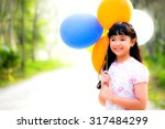 Small photo of smile and cute girl with color-ful balloons