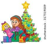 girl unpacking christmas gifts... | Shutterstock .eps vector #317519009