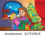 girl unpacking christmas gifts...   Shutterstock .eps vector #317519015