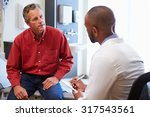 male patient and doctor have... | Shutterstock . vector #317543561