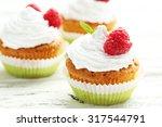 Raspberry Cupcakes On White...