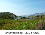 Alpine Lake And Mountains In...