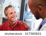 male patient being reassured by ... | Shutterstock . vector #317585831