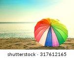 colourful umbrella on the beach ... | Shutterstock . vector #317612165