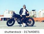 Biker Sexy Woman Sitting On...