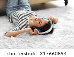 woman listening music in... | Shutterstock . vector #317660894