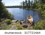 A Yellow Fisherman's Canoe On A ...