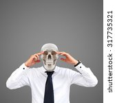 human skull on businessman ... | Shutterstock . vector #317735321