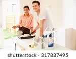 young couple decorating a room  ... | Shutterstock . vector #317837495