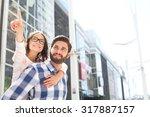 smiling woman pointing away...   Shutterstock . vector #317887157