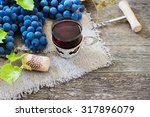 red wine and grapes. wine and... | Shutterstock . vector #317896079