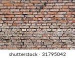grungy brick wall semi wide - stock photo