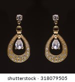 gold earrings with white little