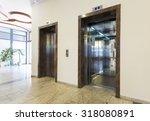 two elevators in hotel lobby
