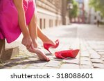 woman with injured ankle | Shutterstock . vector #318088601