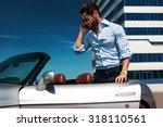 handsome man near the car.... | Shutterstock . vector #318110561