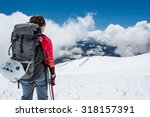 Small photo of Female alpinist enjoying a mountain view. Close up of mountaineer.