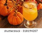 orange drink on fall background ...   Shutterstock . vector #318194207