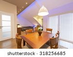 Small photo of Interior of a modern apartment - dining area