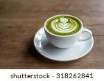 matcha latte on a wooden... | Shutterstock . vector #318262841