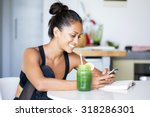 woman drinking a homemade green ... | Shutterstock . vector #318286301
