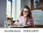 Young Woman Eating Salad At...